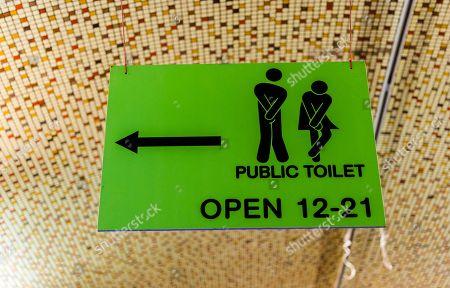Public Toilet, green direction sign, Prague, Czech Republic