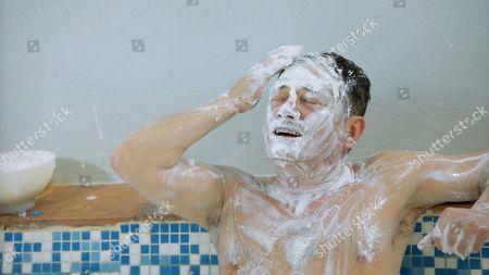 Stock Image of Sid Owen has a goats milk bath