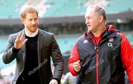 Prince Harry waves to supporters - with Richard Hill
