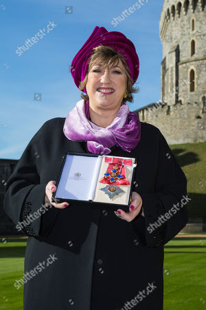 Dames Commander Dame Rosemary Squire of Pyrford, co-founder of the Ambassador Theatre Group Limited displays her award for theatre and services to philanthropy at an investiture ceremony at Windsor Castle