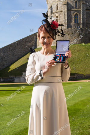 Stock Picture of Miss Helen Sharman CMG, OBE of Kew, who became the first British astronaut and the first woman to visit the Mir space station in 1991, displays her Most Distinguished Order of St Michael and Saint George for services to Science and technology educational outreach at an investiture ceremony at Windsor Castle