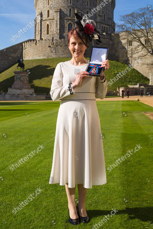 Miss Helen Sharman CMG, OBE of Kew, who became the first British astronaut and the first woman to visit the Mir space station in 1991, displays her Most Distinguished Order of St Michael and Saint George for services to Science and technology educational outreach at an investiture ceremony at Windsor Castle
