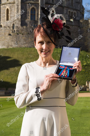 Stock Image of Miss Helen Sharman CMG, OBE of Kew, who became the first British astronaut and the first woman to visit the Mir space station in 1991, displays her Most Distinguished Order of St Michael and Saint George for services to Science and technology educational outreach at an investiture ceremony at Windsor Castle
