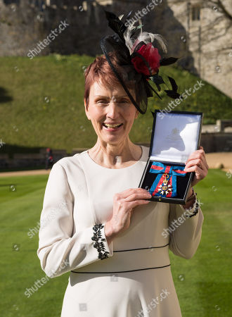 Stock Photo of Miss Helen Sharman CMG, OBE of Kew, who became the first British astronaut and the first woman to visit the Mir space station in 1991, displays her Most Distinguished Order of St Michael and Saint George for services to Science and technology educational outreach at an investiture ceremony at Windsor Castle