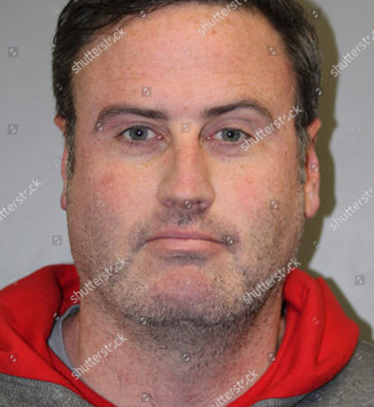 This undated photo provided by the Evergreen Park Police Department In Evergreen Park, Ill., shows Kevin Quinn. Quinn an ex-campaign worker for Illinois House Speaker Michael Madigan's Democratic organization has been arrested for allegedly violating a protective order. Quinn was fired this week for allegedly sending inappropriate text messages to a colleague. Quinn was arrested by Evergreen Park police for violating a protective order by sending text messages and calling another person