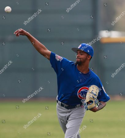 Chicago Cubs relief pitcher Carl Edwards Jr. throws during a drill at the team's spring training baseball facility, in Mesa, Ariz