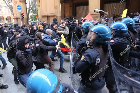 Protester from the social centers clash with police, during a rally against the demonstration of far-right movement 'Forza Nuova', in Bologna, Italy, 16 February 2018. Four students and a policeman were hurt in clashes between leftists and police in Bologna. Police clashed with anticapitalist youths in the northern city amid protests against a rightist extremist leader's planned rally in the traditionally leftwing city. Around 100 students and 'antagonists' were pushed out of Piazza Galvani with several baton charges, by police in riot gear. The leftists, anticapitalists and anarchists had been staging a sit-in in the square, protesting a scheduled rally by far-right Forza Nuova (FN) leader Roberto Fiore in Bologna. Fiore is campaigning for the 04 March general election. ANSA/GIORGIO BENVENUTI