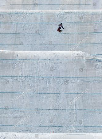Devin Logan, of the United States, jumps during the women's slopestyle qualifying at Phoenix Snow Park at the 2018 Winter Olympics in Pyeongchang, South Korea