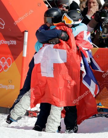 Bronze medal winner Isabel Atkin, of Britain, left, and silver medal winner Mathilde Gremaud, of Switzerland, embrace gold medal winner Sarah Hoefflin, of Switzerland, after the women's slopestyle finals at Phoenix Snow Park at the 2018 Winter Olympics in Pyeongchang, South Korea