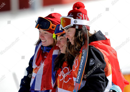From left; Bronze medal winner Isabel Atkin, of Britain, gold medal winner Sarah Hoefflin, of Switzerland, and silver medal winner Mathilde Gremaud, of Switzerland, celebrate after the women's slopestyle finals at Phoenix Snow Park at the 2018 Winter Olympics in Pyeongchang, South Korea