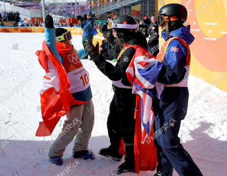 Gold medal winner Sarah Hoefflin, of Switzerland, (10), celebrates with silver medal winner Mathilde Gremaud, of Switzerland, and bronze medal winner Isabel Atkin, of Britain, after the women's slopestyle finals at Phoenix Snow Park at the 2018 Winter Olympics in Pyeongchang, South Korea