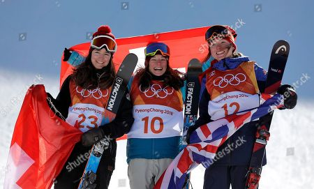 From left; Silver medal winner Mathilde Gremaud, of Switzerland, gold medal winner Sarah Hoefflin, of Switzerland, and broke medal winner Isabel Atkin, of Britain, celebrate after the women's slopestyle finals at Phoenix Snow Park at the 2018 Winter Olympics in Pyeongchang, South Korea