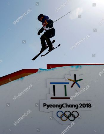 Isabel Atkin, of Britain, jumps during the women's slopestyle qualifying at Phoenix Snow Park at the 2018 Winter Olympics in Pyeongchang, South Korea
