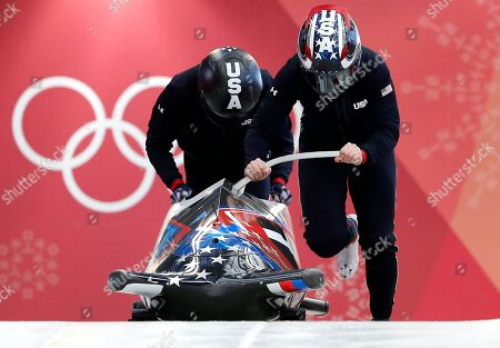 Driver Jamie Greubel Poser and Aja Evans of the United States start a women's bobsled training run at the 2018 Winter Olympics in Pyeongchang, South Korea