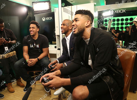 Rukari Austin, Chris Paul, Karl-Anthony Towns. Rukari Austin, from left, Chris Paul and Karl-Anthony Towns attend the Xbox Barber Shop at One Court, presented by the National Basketball Players Association, in West Hollywood, Calif