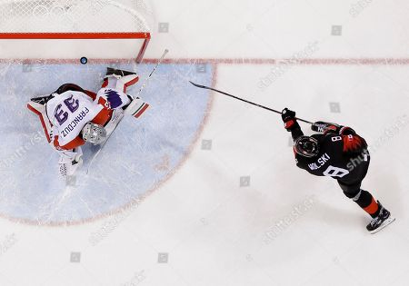 Wojtek Wolski (8), of Canada, scores past goalie Pavel Francouz (33), of the Czech Republic, in the penalty shootout during the overtime period of the preliminary round of the men's hockey game at the 2018 Winter Olympics in Gangneung, South Korea