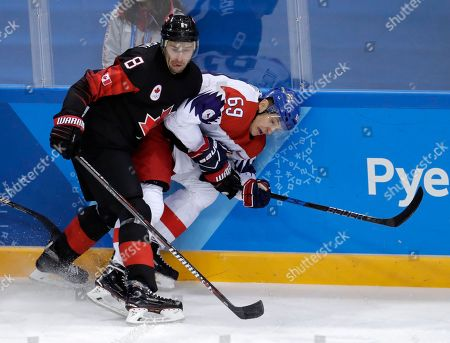 Wojtek Wolski (8), of Canada, checks Lukas Radil (69), of the Czech Republic, during the first period of the preliminary round of the men's hockey game at the 2018 Winter Olympics in Gangneung, South Korea