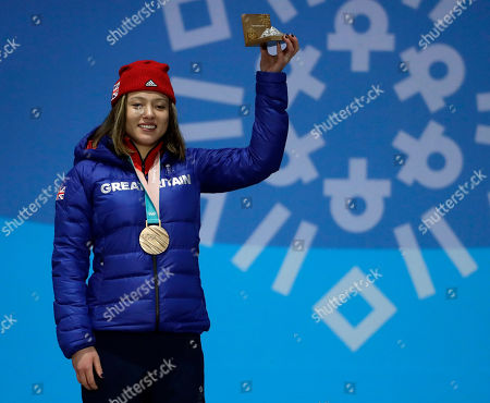 Bronze medalist in the women's slopestyle Isabel Atkin, of Britain, smiles during the medals ceremony at the 2018 Winter Olympics in Pyeongchang, South Korea