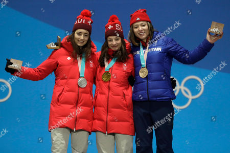 Medalists in the women's slopestyle, from left, Switzerland's Mathilde Gremaud, silver, Switzerland's Sarah Hoefflin, gold, and Britain's Isabel Atkin, bronze, pose during their medals ceremony at the 2018 Winter Olympics in Pyeongchang, South Korea