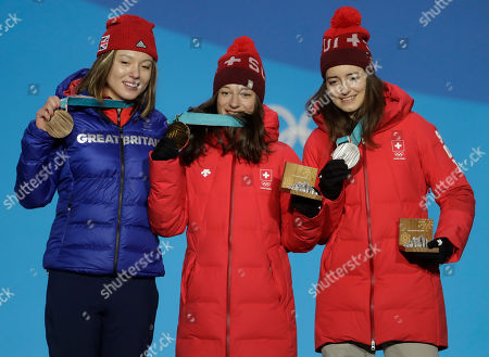 Medalists in the women's slopestyle, from right, Switzerland's Mathilde Gremaud, silver, Switzerland's Sarah Hoefflin, gold, and Britain's Isabel Atkin, bronze, pose during their medals ceremony at the 2018 Winter Olympics in Pyeongchang, South Korea