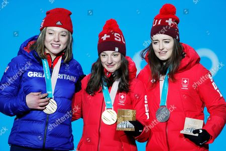 Gold medallist Sarah Hoefflin (C) of Switzerland, Silver medallist Mathilde Gremaud (R) of Switzerland and Bronze medalist Isabel Atkin of Great Britain (R) during the medal ceremony for the women's Slopestyle Freestyle event at the PyeongChang 2018 Olympic Games, South Korea, 17 February 2018.