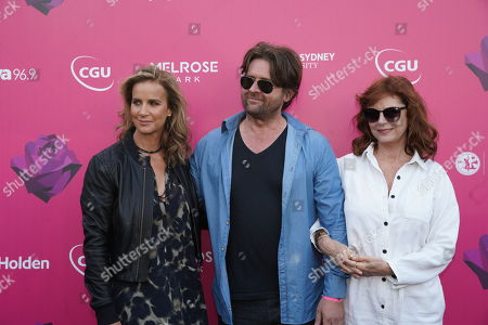 Stock Image of (L-R) Rachel Griffiths, John Polson and Susan Sarandon pose for photographs on the black carpet ahead of the 2018 Tropfest Film, Food and Live entertainment festival at Parramatta Park in Sydney, Australia, 17 February 2018. The festival is described by its organizers as the 'World's Largest Short Film Festival'.