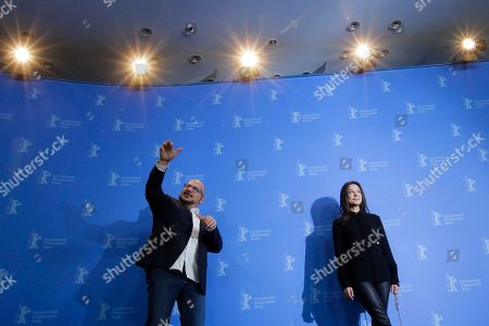 Actors Piotr Gasowski, left, and Elena Lyadova pose at the photo-call on the film Dovlatov during the 68th edition of the International Film Festival Berlin, Berlinale, in Berlin, Germany