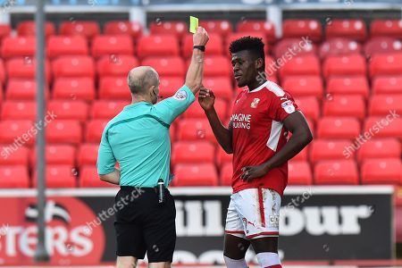 Matthew Taylor (32) of Swindon Town is shown a yellow card, booked by referee Andy Woolmer during the EFL Sky Bet League 2 match between Swindon Town and Port Vale at the County Ground, Swindon. Picture by Graham Hunt