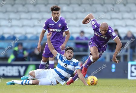 Massimo Luongo of QPR tackles former QPR team mate Karl Henry of Bolton Wanderers