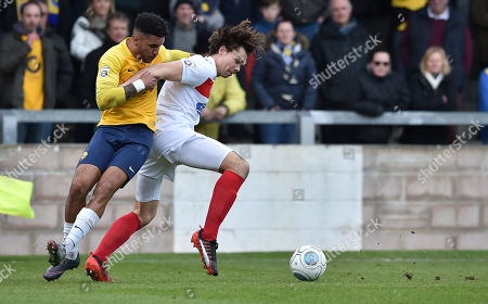 Jamie Reid of Torquay United challenges for the ball with Craig Robson of Dagenham & Redbridge, during the Vanarama National League match between Torquay United and Dagenham & Redbridge at Plainmoor, Torquay, Devon on February 17