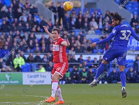 Armand Traore (32) of Cardiff City heads at goal during the Sky Bet Championship game, between Cardiff City and Middlesbrough at the Cardiff City Stadium, on February 17th 2018 in Cardiff, UK.