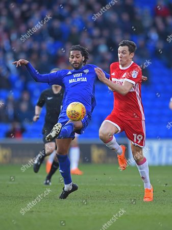 Stewart Downing (19) of Middlesbrough battles with Armand Traore (32) of Cardiff City during the Sky Bet Championship game, between Cardiff City and Middlesbrough at the Cardiff City Stadium, on February 17th 2018 in Cardiff, UK.