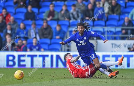 Armand Traore (32) of Cardiff City fouled by Muhamed Besic (27) of Middlesbrough who gets a yellow card during the Sky Bet Championship game, between Cardiff City and Middlesbrough at the Cardiff City Stadium, on February 17th 2018 in Cardiff, UK.