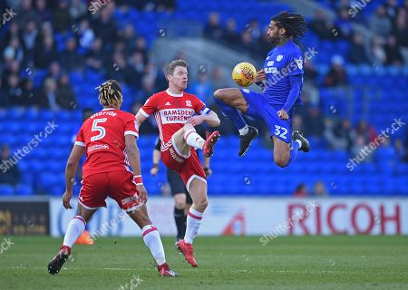 Armand Traore (32) of Cardiff City under pressure from Grant Leadbitter (7) of Middlesbrough during the Sky Bet Championship game, between Cardiff City and Middlesbrough at the Cardiff City Stadium, on February 17th 2018 in Cardiff, UK.