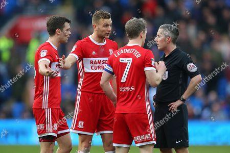 Jonatahan Howson, Ben Gibson and Grant Leadbitter speak with referee Darren Bond