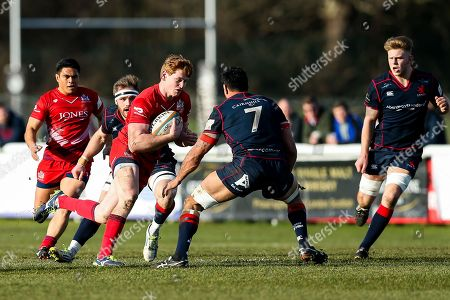 Jack Tovey of Bristol Rugby is challenged by Chris Walker of London Scottish