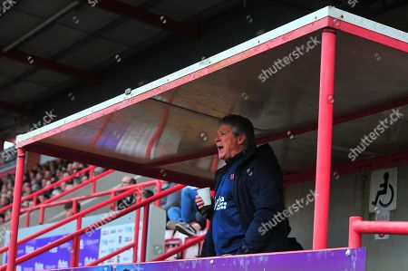Stock Picture of Steve Perryman, Director of Football of Exeter City shouts instructions from the stand during the Sky Bet League 2 Match between Exeter City and Mansfield Town at St James Park, Exeter, Devon on February 17.