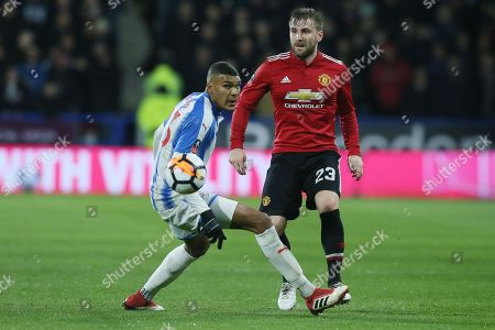 Luke Shaw of Manchester United and Collin Quaner of Huddersfield Town
