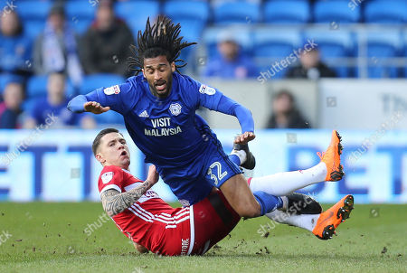Armand Traore of Cardiff City is brought down by Muhamed Besic of Middlesbrough