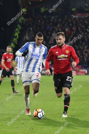 Manchester United Luke Shaw & Huddersfield's Collin Quaner during the The FA Cup match between Huddersfield Town and Manchester United at the John Smiths Stadium, Huddersfield. Picture by George Franks