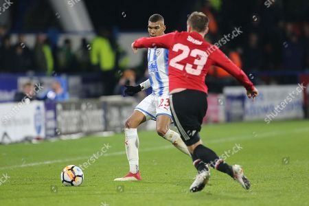 Manchester United Luke Shaw goes for the ball from Huddersfield's Collin Quaner during the The FA Cup match between Huddersfield Town and Manchester United at the John Smiths Stadium, Huddersfield. Picture by George Franks