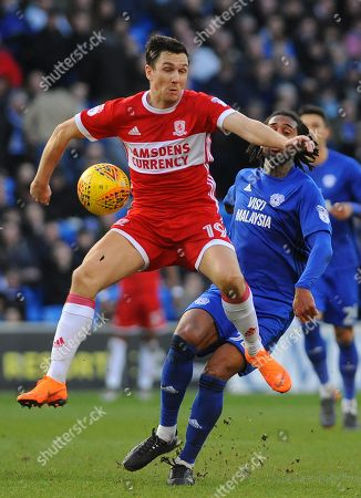 Stewart Downing of Middlesbrough and Armand Traore of Cardiff City compete for the highball
