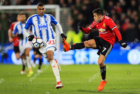 Alexis Sanchez of Manchester United and Collin Quaner of Huddersfield Town