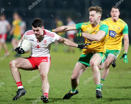 Donegal vs Tyrone. Donegal's Stephen McMenamin with Tyrone's Darren McCurry
