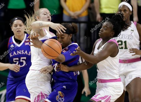 Lauren Cox, Dekeiya Cohen, Austin Richardson. Baylor's Lauren Cox, left, and Dekeiya Cohen, right, combine to strip the ball away from Kansas' Austin Richardson, center, in the second half of an NCAA college basketball game, in Waco, Texas
