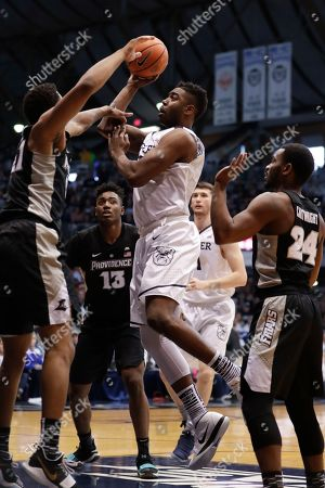 Jalen Lindsey, Kelan Martin. Butler forward Kelan Martin (30) shoots over Providence guard Jalen Lindsey (21) in the first half of an NCAA college basketball game in Indianapolis