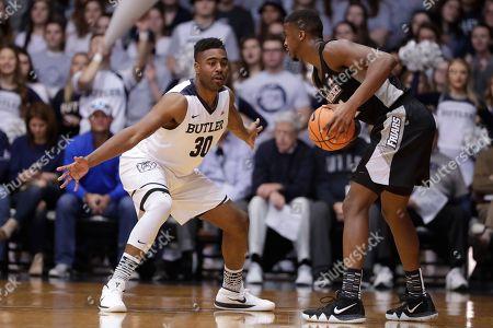 Alpha Diallo, Kelan Martin. Butler forward Kelan Martin (30) defends Providence guard Alpha Diallo (11) in the first half of an NCAA college basketball game in Indianapolis