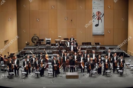 Munich Philarmonic Orchestra with its Spanish director Pablo Heras Casado (C), performs on stage at Tenerife Auditorium in Tenerife, Canary Islands, 17 February 2018, as part of the Canary International Music Festival.