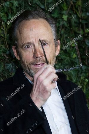 John Benjamin Hickey poses for photographers upon arrival at the Charles Finch and Chanel pre Bafta party in London