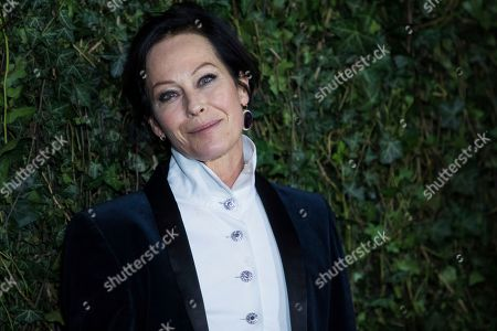 Amanda Harlech poses for photographers upon arrival at the Charles Finch and Chanel pre Bafta party in London